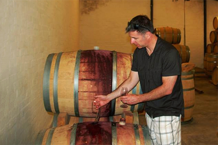 Tasting Wine from the barrel.