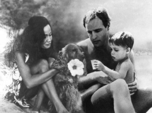 Marlon Brando with his wife Tarita Teriipaia and son Teihotu Brando, vacationing on Tetiaroa in 1965.