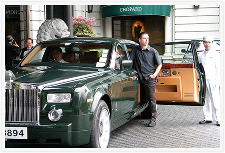 Dean Horvath exiting a Rolls Royce Phantom at the Peninsula Hong Kong